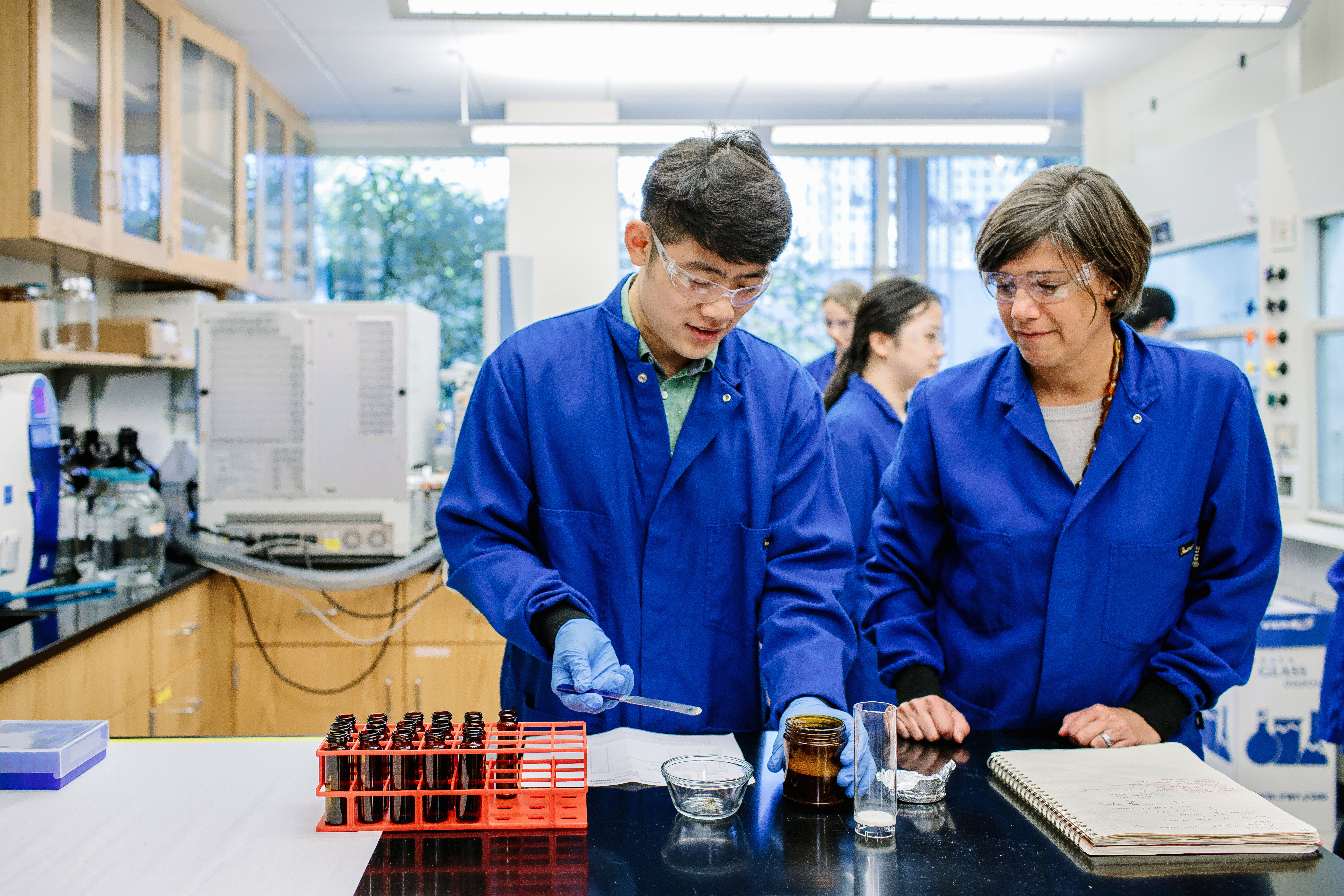 professor and student working in environmental engineering lab