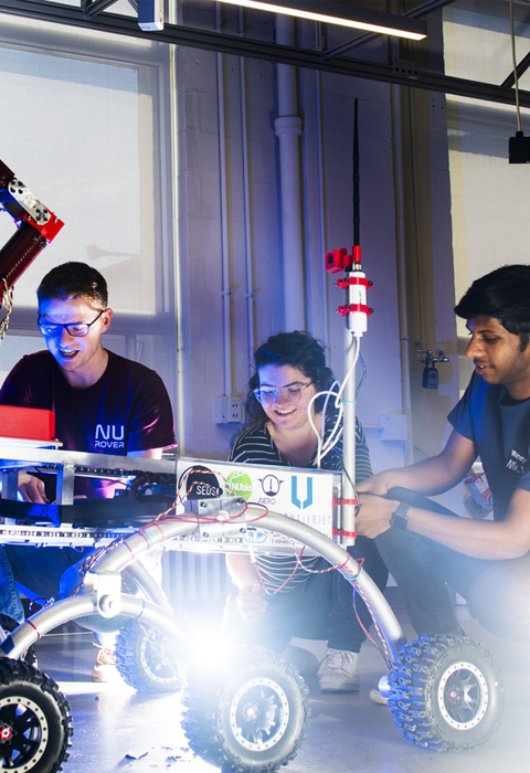 hero image of academics and experiential_students in robotics lab