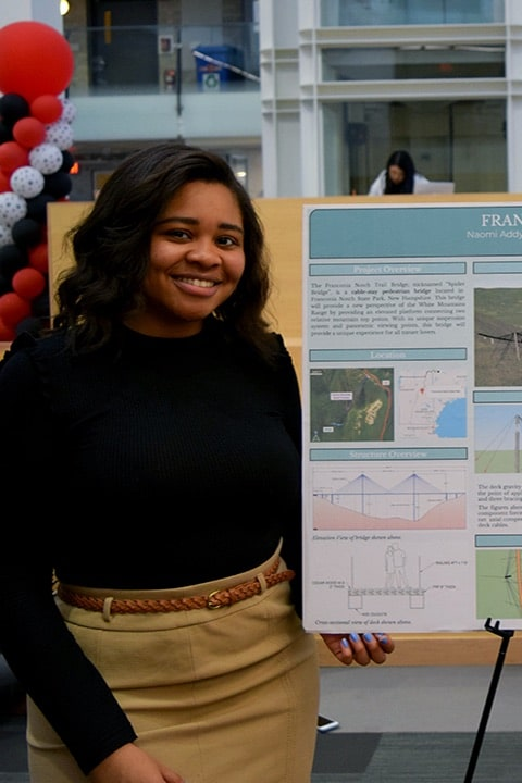 student with research poster