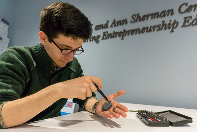 student working in the Sherman Center on his watch invention