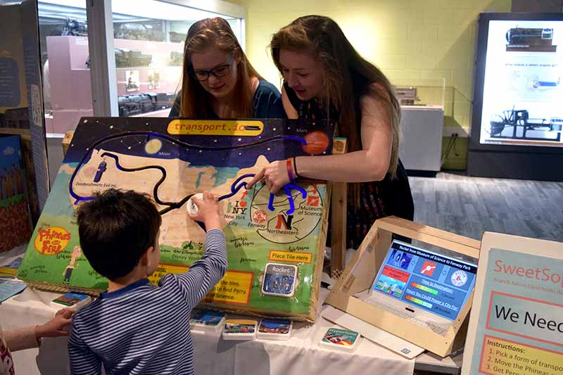 Engineering first year students show a sustainability exhibit at the Museum of Science