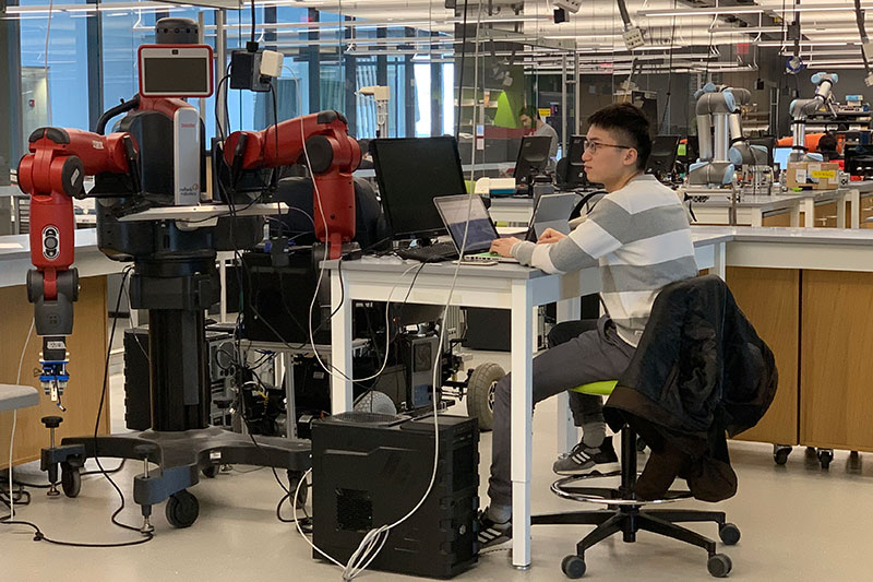 Xupeng Zhu, electrical engineering graduate student, ME'20, works in the new robotics laboratory on the fifth floor of the Interdisciplinary Science and Engineering Complex. The space enables interdisciplinary research in a variety of areas, including manipulation of novel objects, field robotics, aerial robotics, and assistive robotics. With more than 12,000 square feet of space dedicated to robot fabrication, testing, and prototyping, the facility is the home for 16 principal investigators and more than 100 graduate students. It has state-of-the-art robot systems, including collaborative manipulator arms, drones, human support robots and field robots.