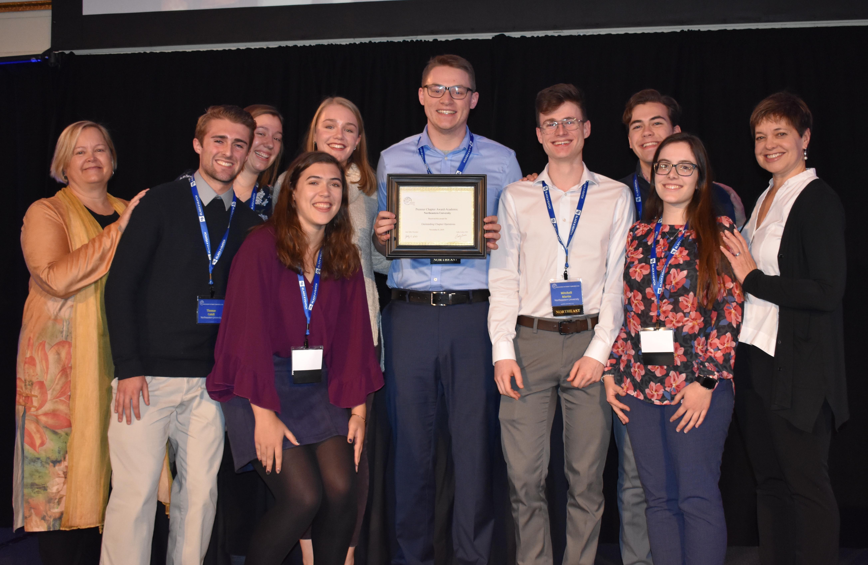 group photo showing award