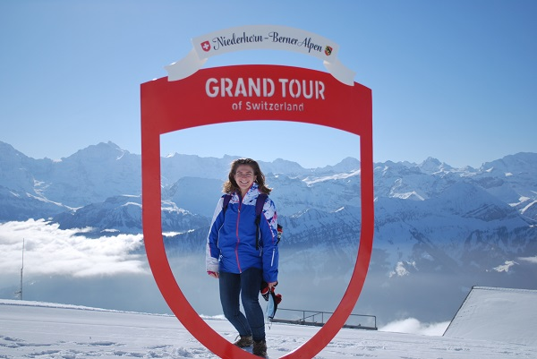 student standing under switzerland grand tour sign
