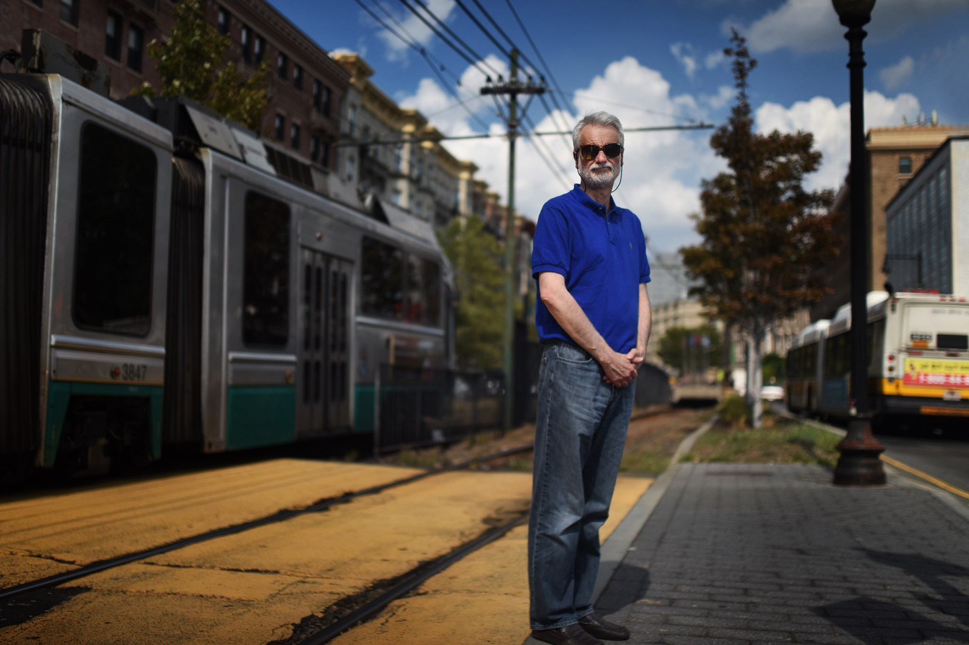 Haris Koutsopoulos, professor of civil and environmental engineering, stands at Northeastern station on the MBTA Green Line. Photo by Matthew Modoono/Northeastern University