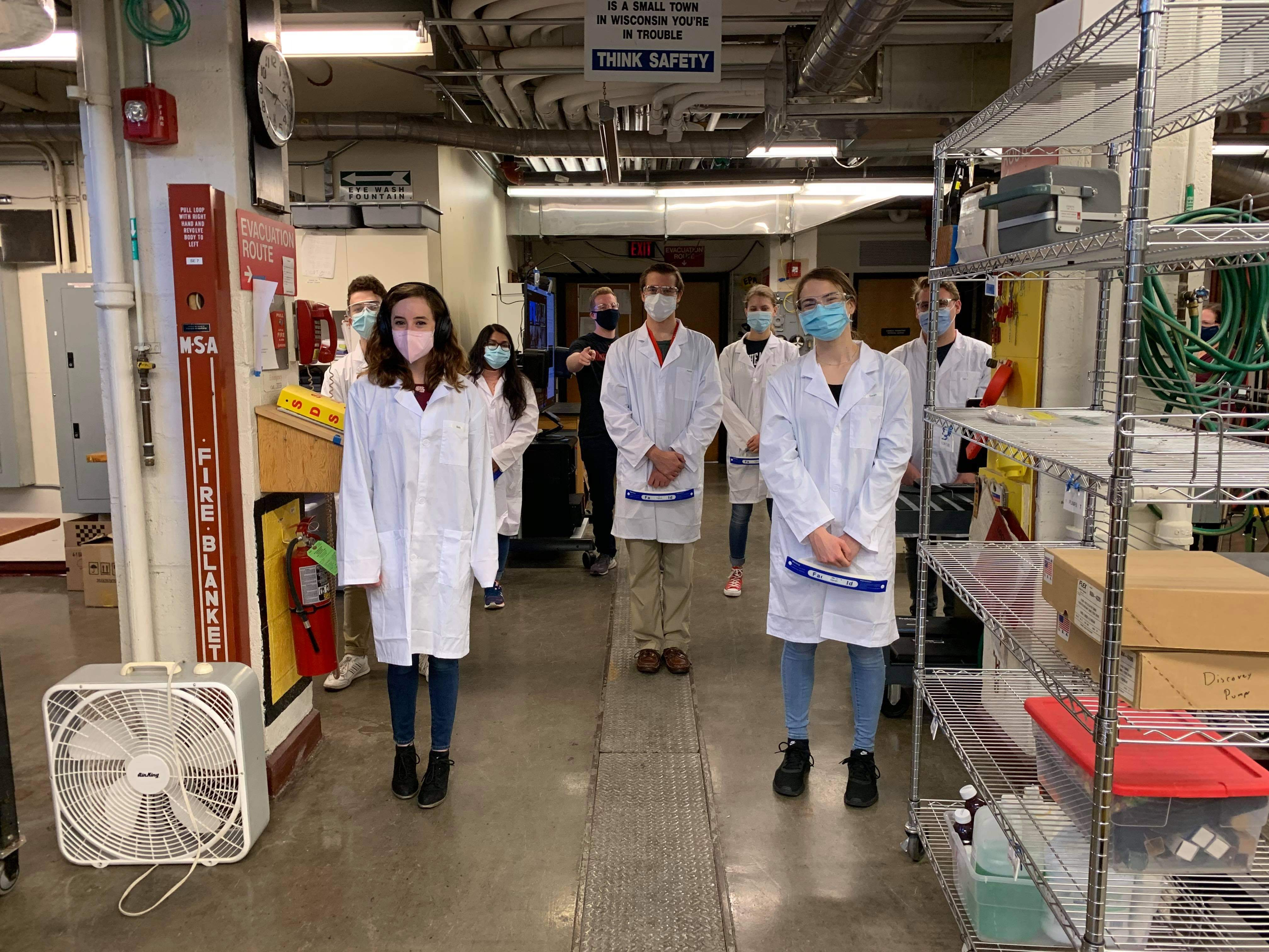 chemical engineering students in lab posing for photo