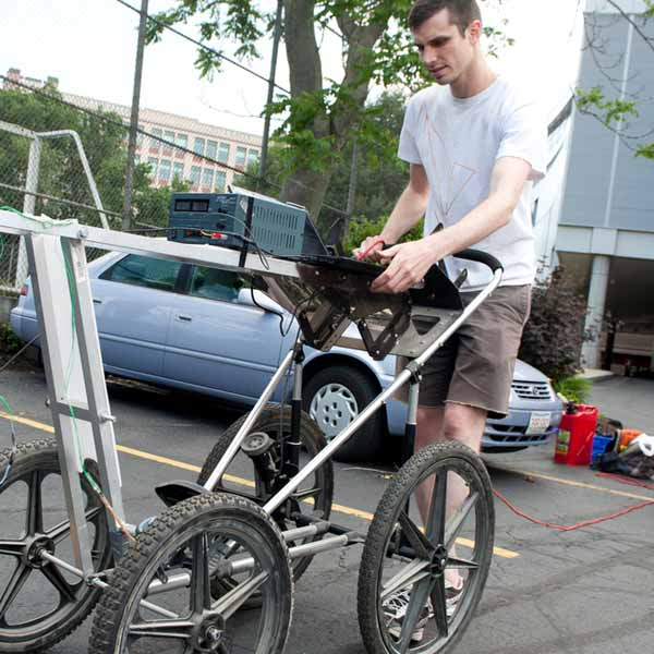 man pushing device with wheels