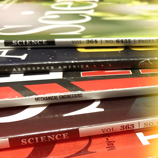 engineering and science magazines in a stack