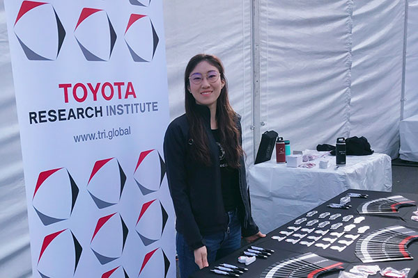 student on co-op standing in front of Toyota Research sign