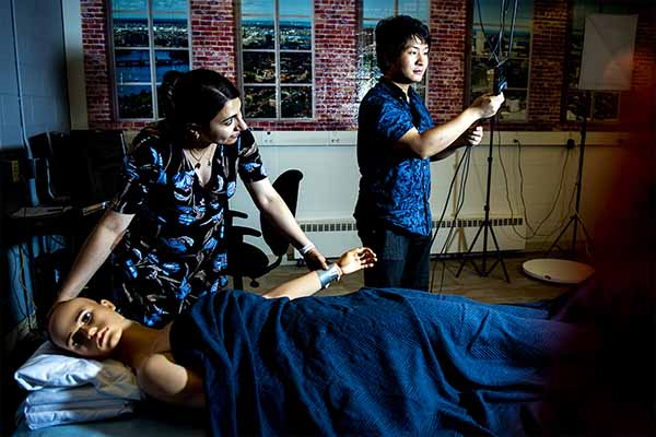 professor and student monitoring sleep behavior