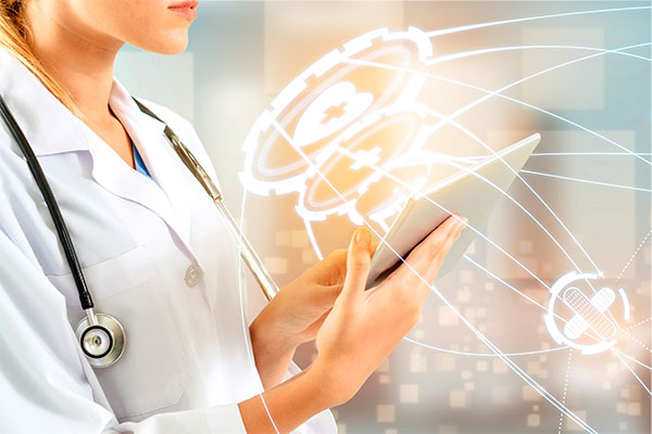 abstract photo of women doctor pointing to tablet with medical imagery around it