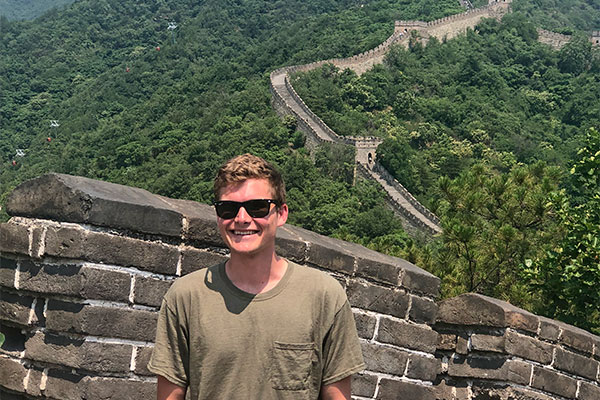 student with Great Wall of China in background