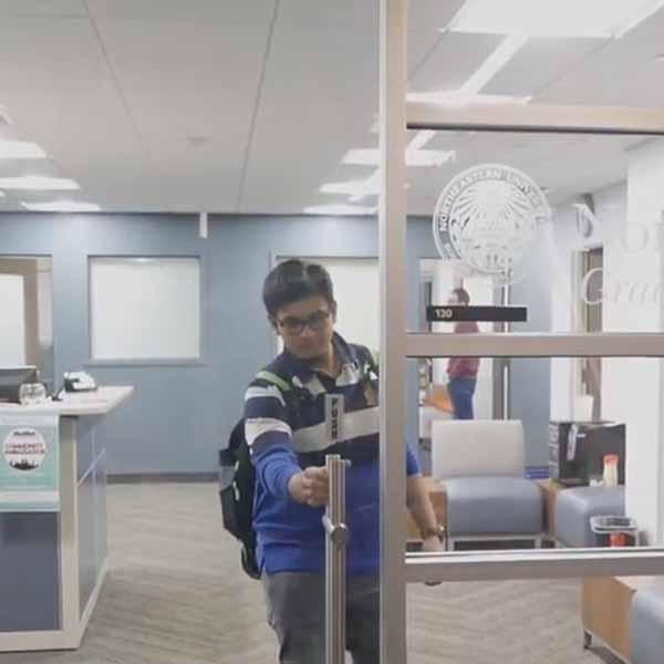 student in striped jersey reaching for door handle