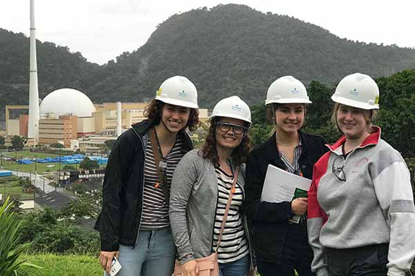 students in Brazil with hardhats at power plant