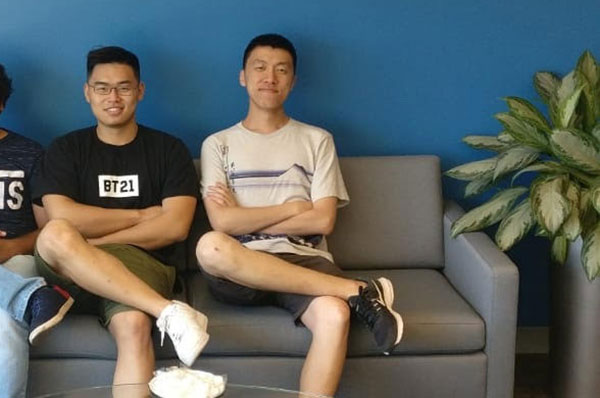 two students sit on couch on co-op at Philips