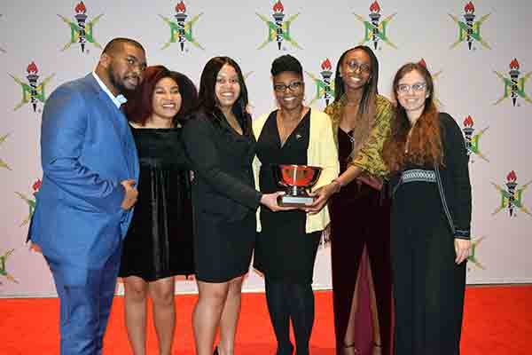 student group accepting award at conference