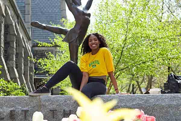 student sitting on wall at Northeastern University