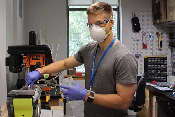 student working in chemical engineering lab
