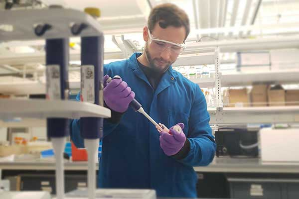 doctoral student working in chemical engineering lab