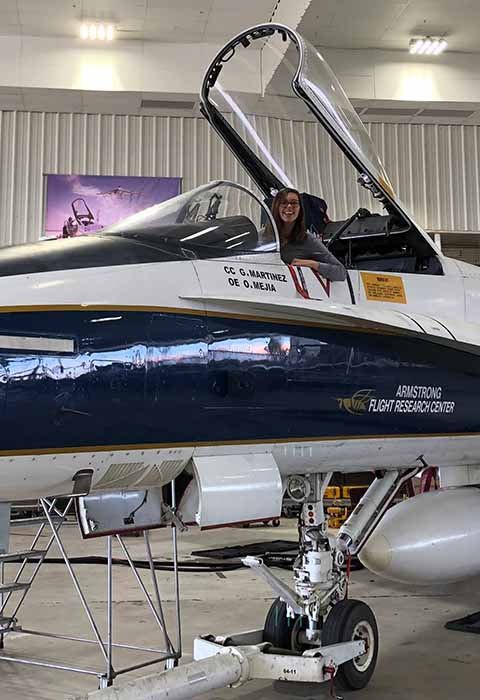 student at NASA sitting in jet