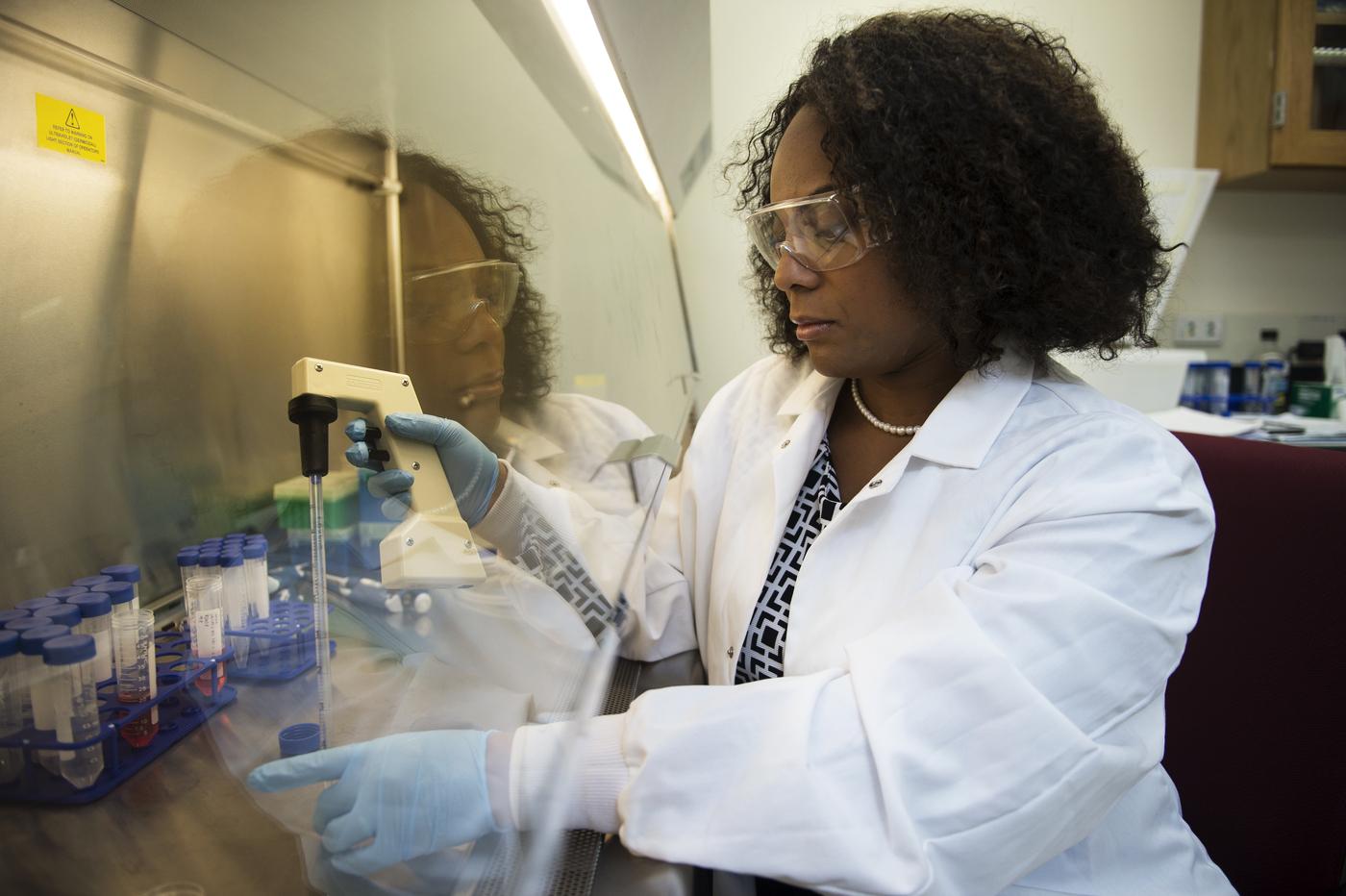 09/14/15 - BOSTON, MA. - Eno Ebong works in her lab on Sept. 14, 2015.  Photo by Adam Glanzman/Northeastern University