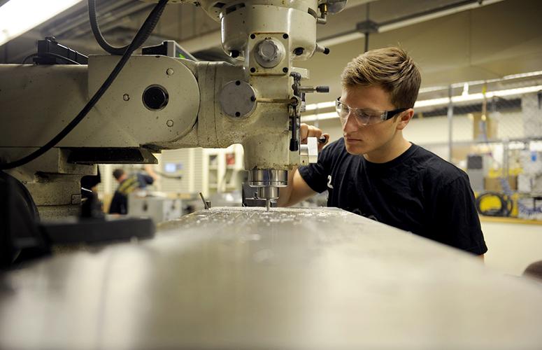 July 8, 2016 - BOSTON, MA. - Ben Lippolis, DMSB'17, works on fabricating parts for the Openloop vehicle in the Richards Machine Shop at Northeastern University on July 8, 2016.  Photo by Matthew Modoono/Northeastern University