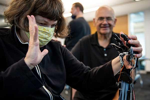 aimi Lard, who is blind and deaf, feels the TATUM robotic hand