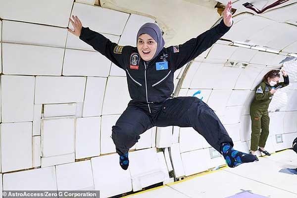 Mona Minkara floats weightless in zero gravity experience.
