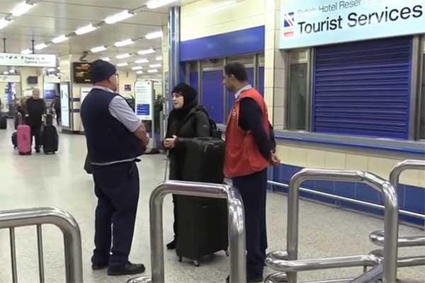 Mona Minkara talks to employees at British transportation station.