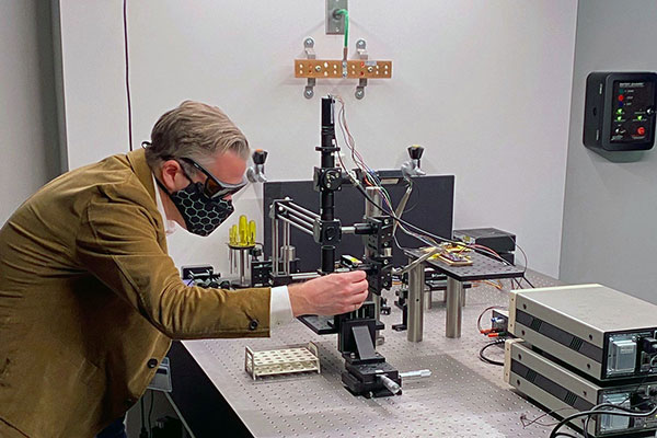professor working in lab on project