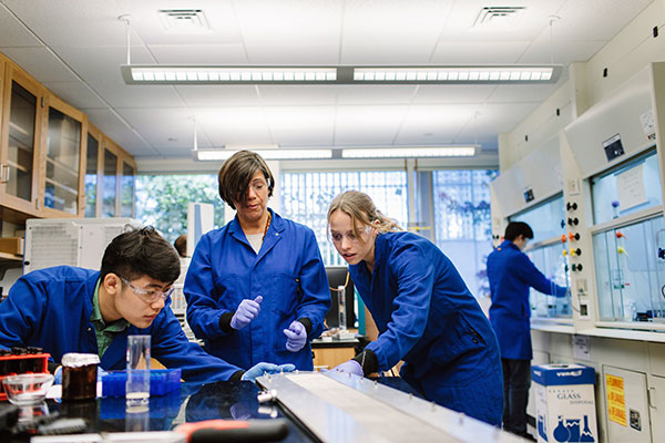 professor with students in environmental lab
