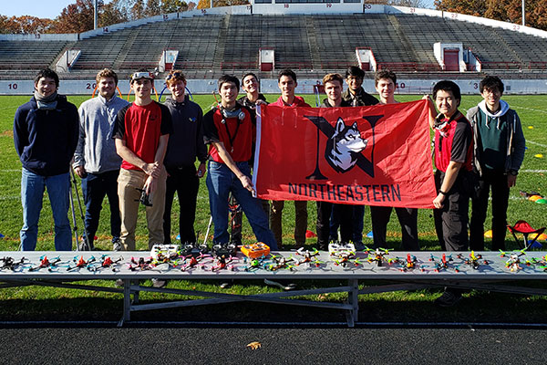 aerospace club group photo holding NU banner