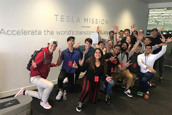 students inside tesla building