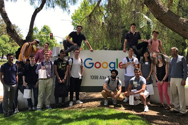 students in front of google sign