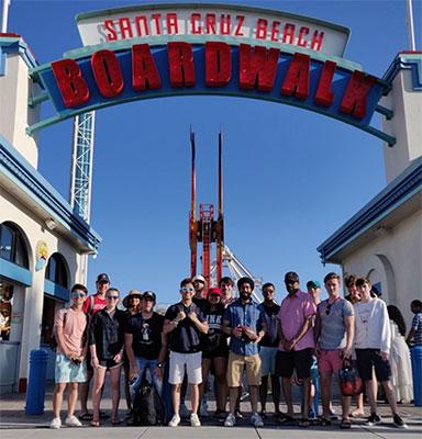 students in front of santa cruz beach boardwalk