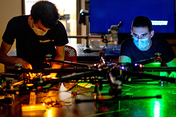 two male students working on drone project