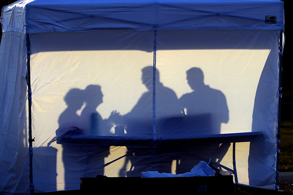 silouette of medical workers in a medical tent