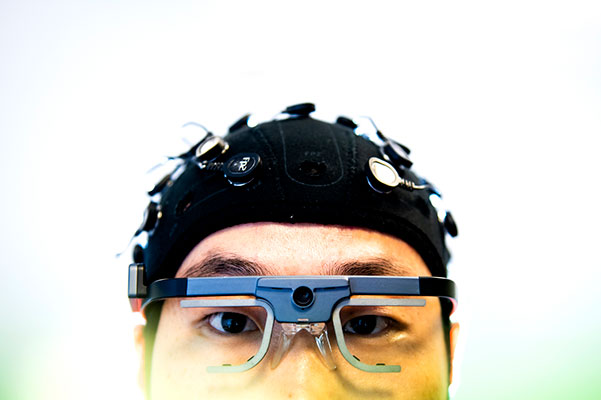 top half of head with cap on and lab glasses as part of testing for pain research
