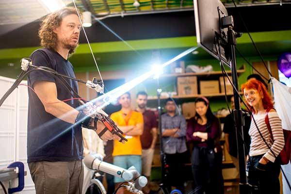 Peter Whitney, professor of engineering, demonstrates robotic teleoperation with haptic feedback.