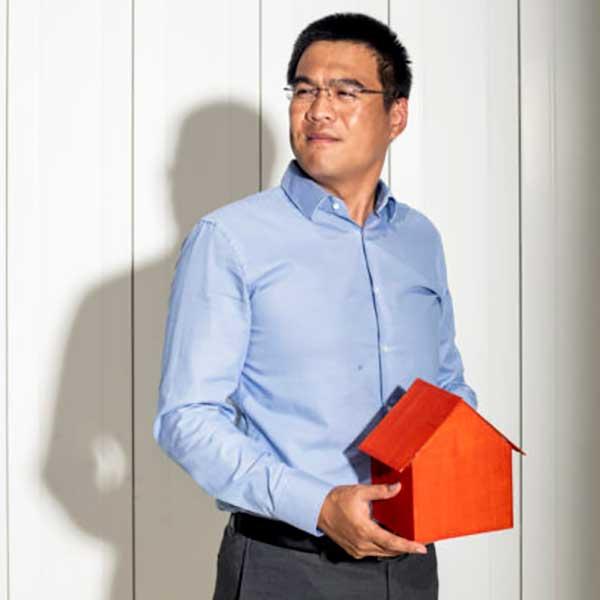 Yi Zheng holding a minature house.