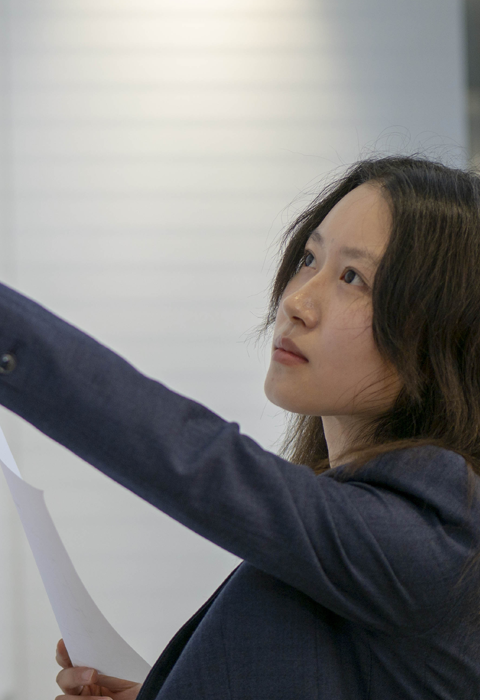 woman pointing at board with data