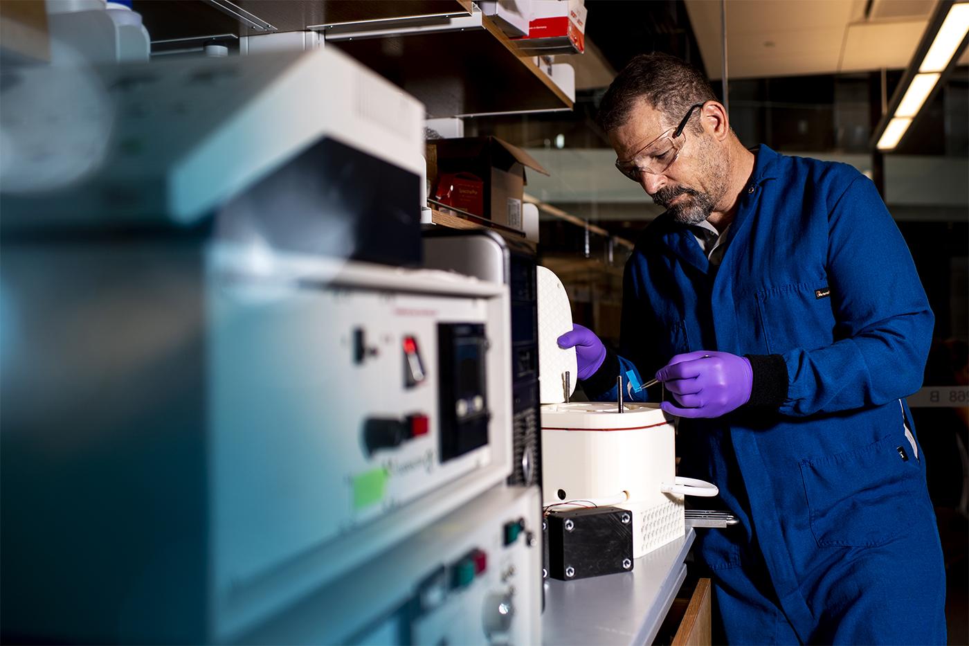 professor working in bioengineering lab