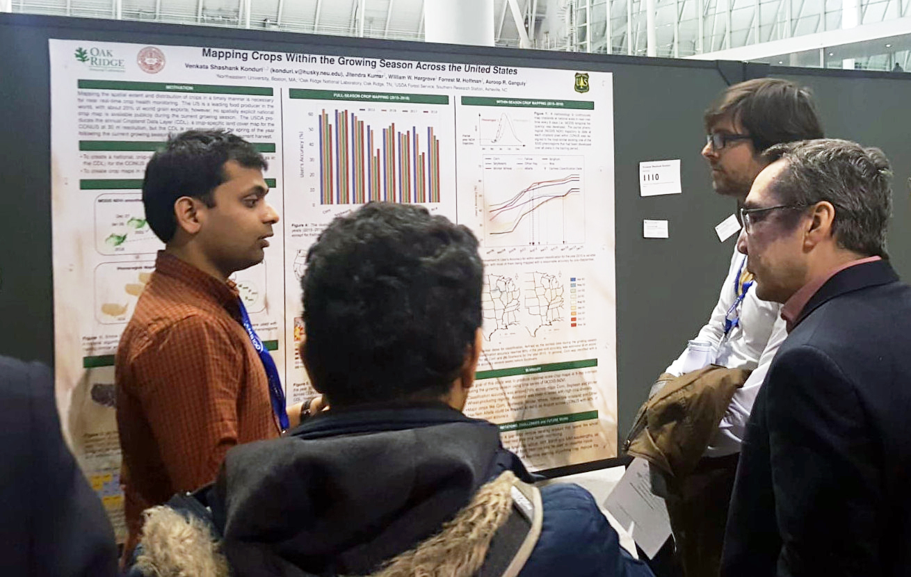 students and faculty at poster symposium